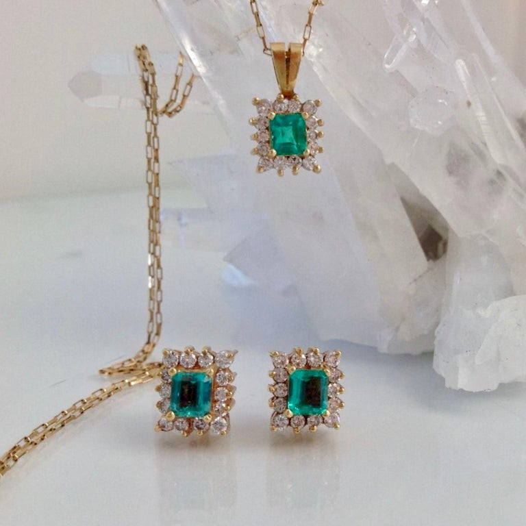 Fine Suite of Natural Colombian Emerald emerald Cut on a Custom Made of Solid 18K Yellow Gold set with diamonds. Great for every day wear! Pendant: Emerald 0.60ct & Diamond 0.39ct (E/VS1) Stud Earrings: Emerald 1.20ct & Diamond 0.78ct (E/VS1) Total