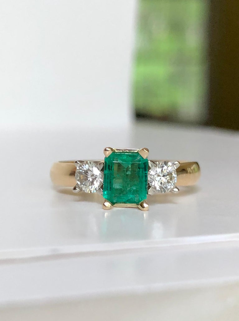 18K yellow gold natural Emerald and Diamond Engagement Ring 3 Stone emerald cut emerald.  Total Emerald weight is 0.51 carats, high clarity, rich green color, excellent brightness from  Colombia. Total Diamond weight is 0.38 carats, round brilliant