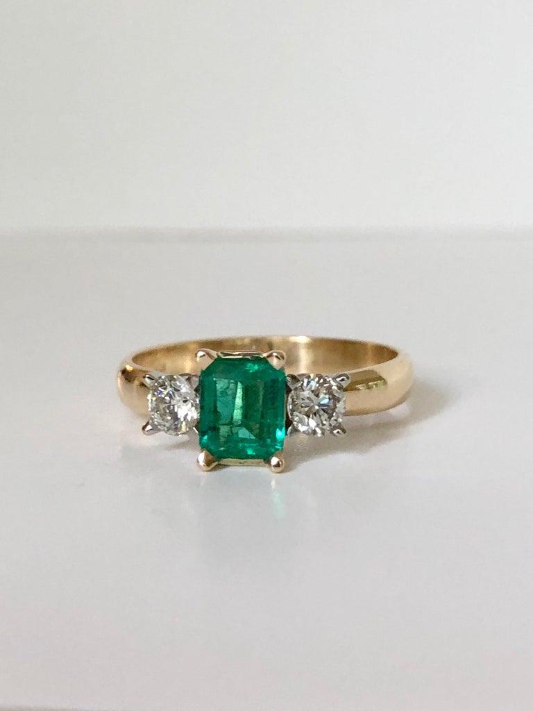 Contemporary Colombian Emerald Diamond Three-Stone Engagement Ring 18 Karat For Sale