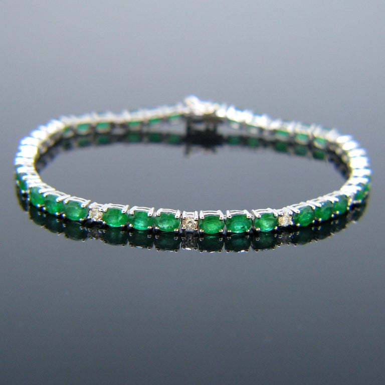 Oval Cut Colombian Emerald Diamonds Tennis Line White Gold Bracelet For Sale