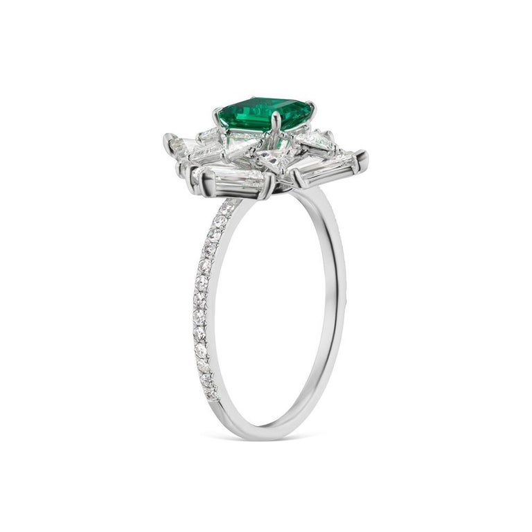 NO OIL EMERALD AND DIAMOND RING A dynamic platinum setting adds extra color and texture to a beautiful emerald and diamond ring. Emerald is colombian and No Oil with AGL Certificate. Item:# 03835 Setting:Platinum Lab:AGL Color Weight:0.71 ct. of