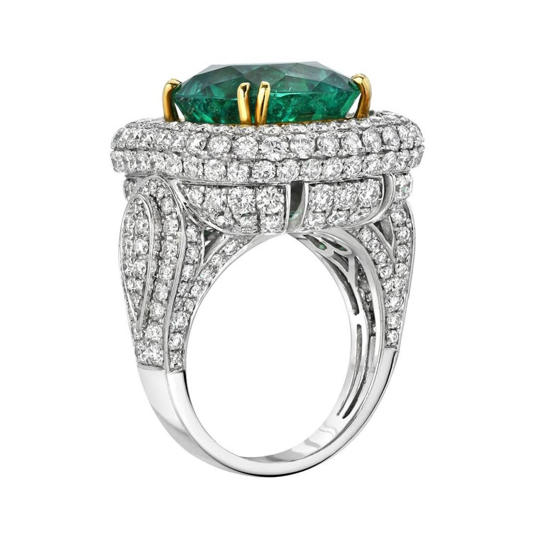 Vibrant and extremely brilliant 9.07 carat Colombian emerald cushion is hand set in this spectacular 4.76 carat diamond, platinum and 18K yellow gold ring. Gubelin certificate attached. Size 6.5. Resizing is complementary upon request.  ***Returns