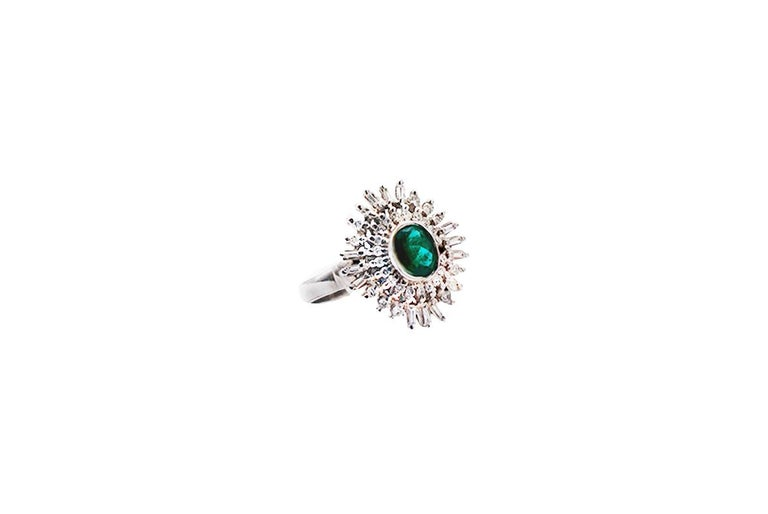 Colombian Emerald, Spray Diamond Cocktail Ring, 18 Karat White Gold Spectacular colored, oval shaped emerald is a deep green color measuring 4.95 x 6.65 mm in diameter weighing approximately 1.25 carat. The diamonds spray of diamonds consists of
