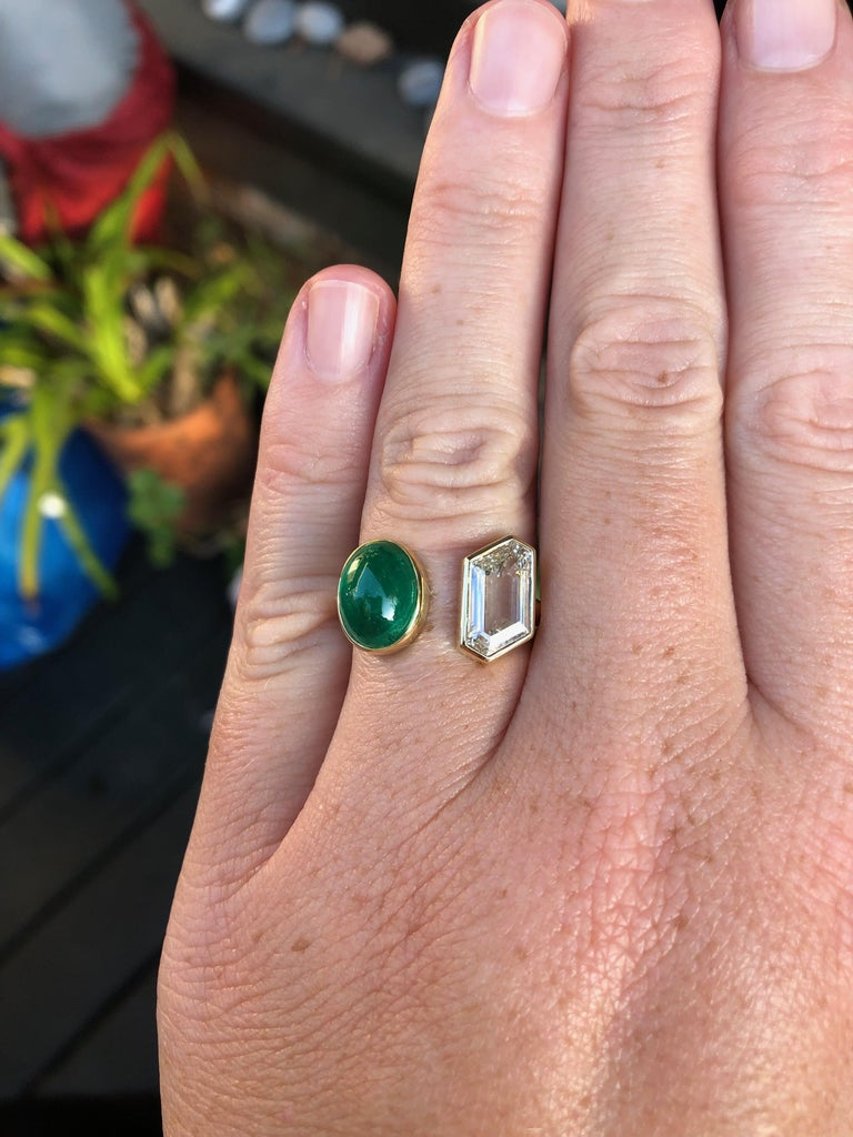 3.5 carat Colombian Muzo cabochon emerald and 1.86 carat GIA certified fancy shape diamond hand fabricated in 18 and 22 karat recycled gold. This emerald was sourced directly from Colombia through our collaboration with IEEX Emeralds. This one of a