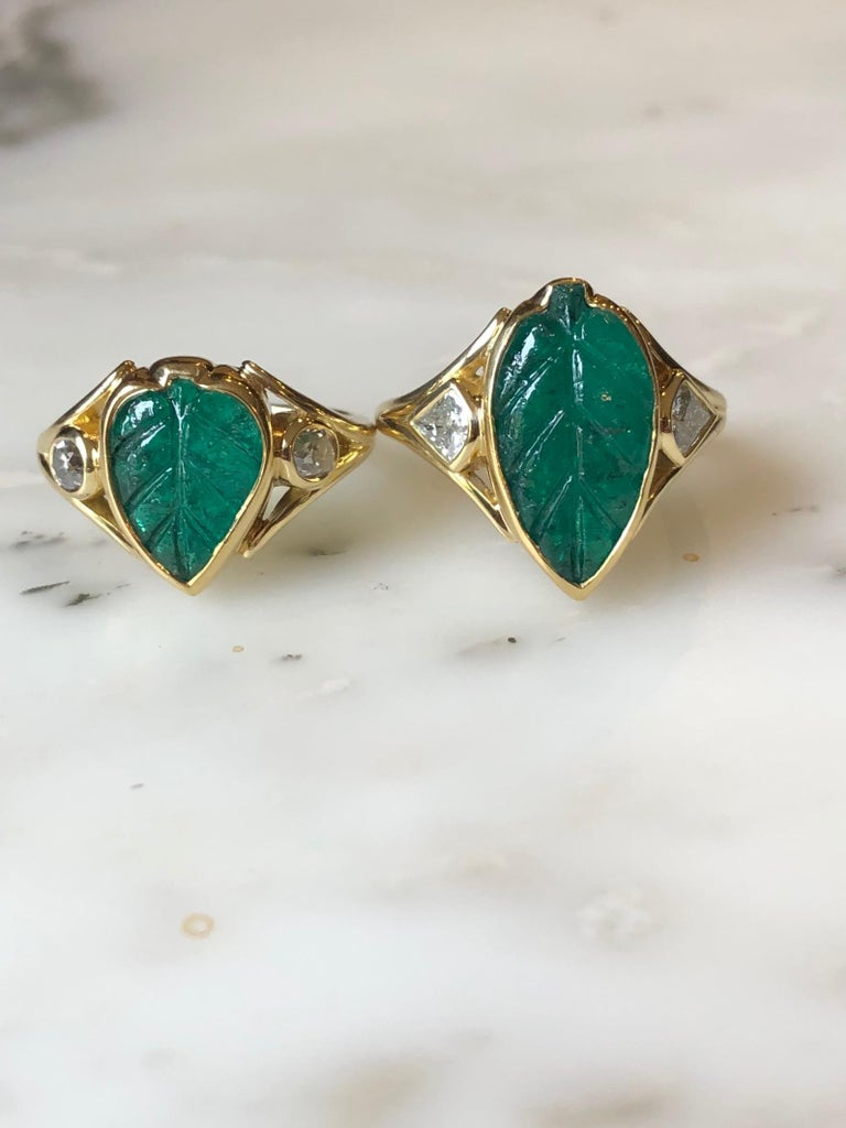 Hand carved Muzo Colombian emerald leaf ring with antique VS+ diamonds flanking. This emerald was sourced directly from Colombia through our collaboration with IEEX Emeralds. This ring is made by hand using ancient gold-smithing techniques in