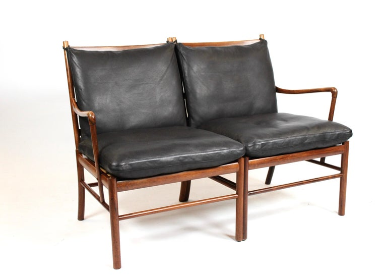 Colonial 2-seat sofa, model OW149-2, designed by Ole Wanscher in 1964 and manufactured by P. Jeppesen in the 1960s. The sofa is of rosewood with black leather cushions and is in great vintage condition.