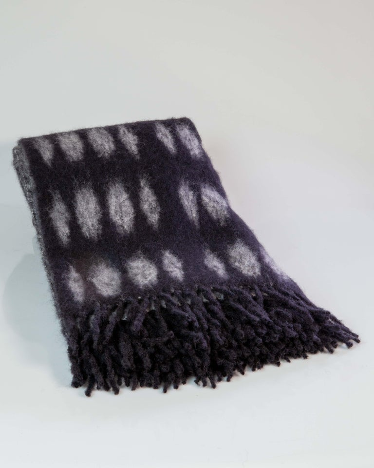Mantas Ezcaray was founded in 1930 in La Rioja, Northern Spain, by Cecilio Valgañón, who transformed the hand loom processes of turning woolen cloth into handkerchiefs, scarves, shawls and blankets, in stock. Their master craftsmen use only the