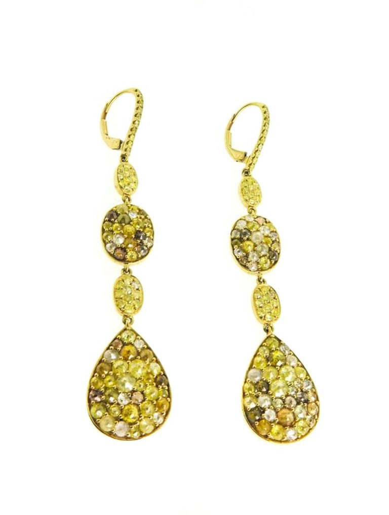 These artistically designed and  fascinating earrings embellish the enchanting radiance of the exceptionally shaped rose cut diamond with white, champagne and fancy yellow colored diamonds weighing in approximately 8.82 carats for a glamorous