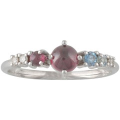 Colorful 18 Karat Gold Ring with Aquamarines, Garnets and Diamond