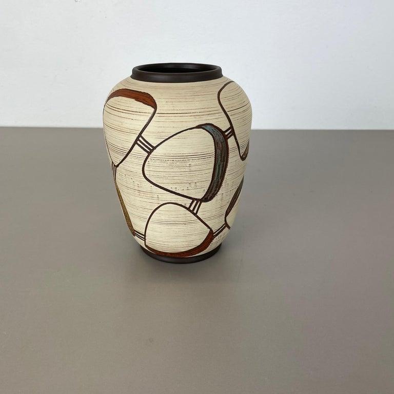 Article:  Pottery ceramic vase   Producer:  Sawa Ceramic, Germany   Design:  Franz Schwaderlapp    Decade:  1950s    Description:  Original vintage 1950s pottery ceramic vase in Germany. High quality German production with a