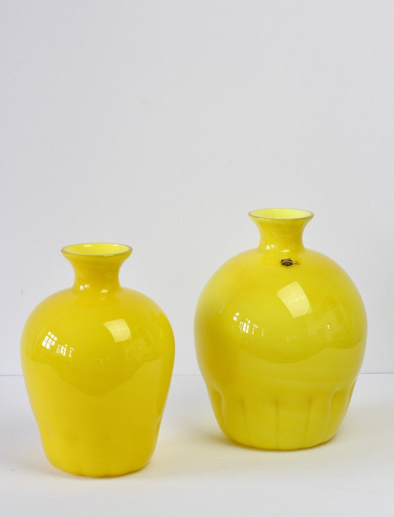 Colorful or colorful pair, group or ensemble of midcentury style bright yellow vases by Cenedese Vetri of Murano, Italy, circa 1990s. Particularly striking is the narrow necked round form with rippled bases, very similar to Napoleone Martinuzzi