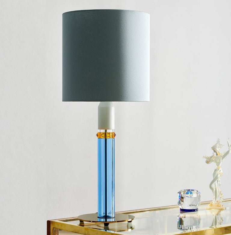 Colorful crystal table lamp, hand-sculpted contemporary crystal Hand-sculpted in crystal Measures: Height 72 cm Width 30 cm Weight: 3.5 kg Material: Fine hand cut crystal and brass coated iron  With blasting colour combinations, a brave
