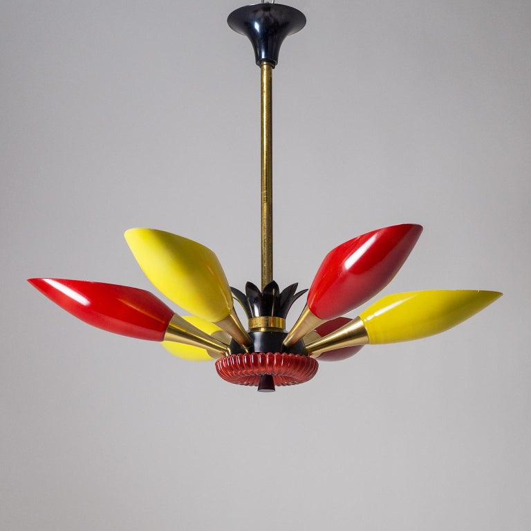Very rare French colorful glass uplight chandelier, circa 1960. Alternating yellow and red enameled glasses are mounted on brass and anodized aluminum hardware with a red glass centerpiece. Very nice original condition with patina on the brass stem