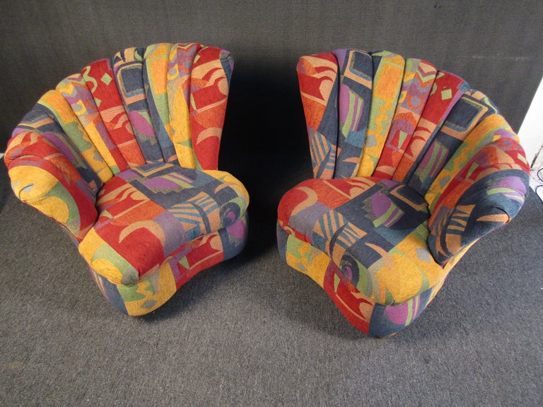 A quirky pair of club chairs that are sure to pop in any space with their playful color and patterning. An interesting Mid-Century Modern design offers comfortable seating while brightening up any space. Please confirm item location with seller