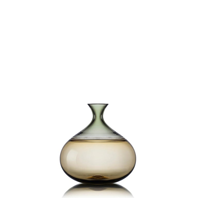 Collection of three hand blown glass statement vessels featuring smoky translucent hues and gold-leaf details. Each colorful vase is composed of two hues fused with a gold-flecked seam at the shoulder. The collection by Vetro Vero is named