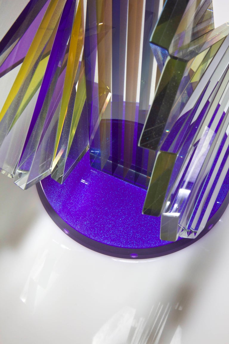 """ST#5: Shifting transmission - A laminated construction of cut, ground and polished 1/4"""" clear glass. The bars, core and base are laminated with alternating Violet, Yellow and 'Dreaming of blue Rainbow' special effect pigments."""