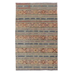 Colorful Turkish Kilim with Stripes and Geometric Elements in Orange and Green