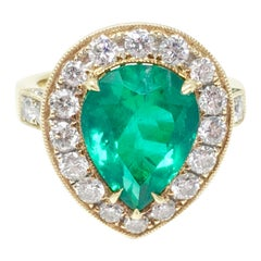 Columbian Emerald and Diamond Ring in 18 Karat Yellow and White Gold