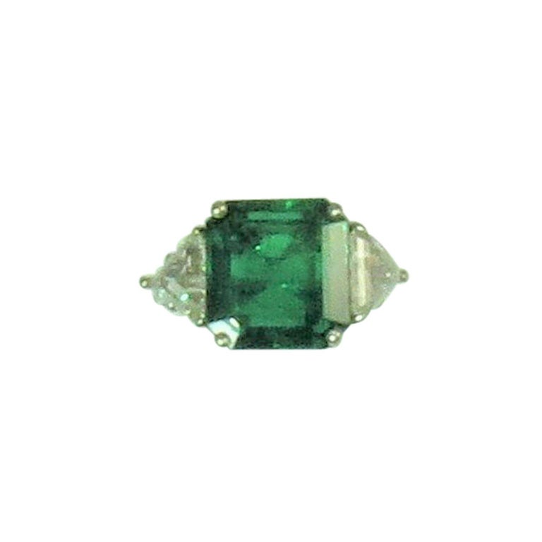 Columbian Emerald Cut Emerald and Triangular Diamond Platinum Ring For Sale