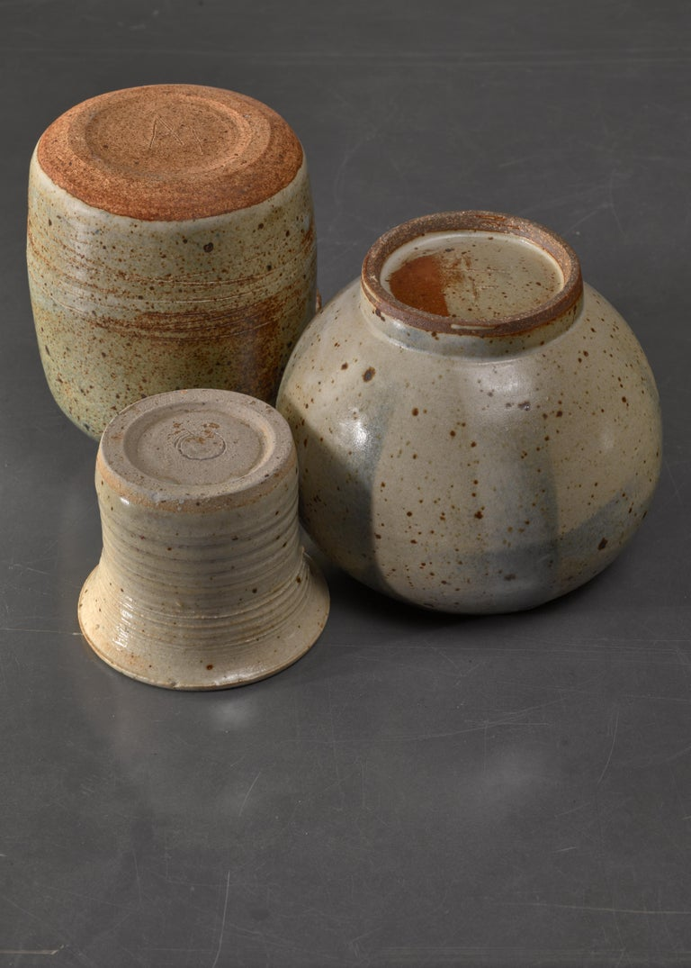 A combination of three Franco Agnese ceramic pieces; an ikebana vase, a small vase and a small jar in greystone.  Beautiful composition in itself that can be enhanced with some small flowers or plants.  The measurements stated are of the