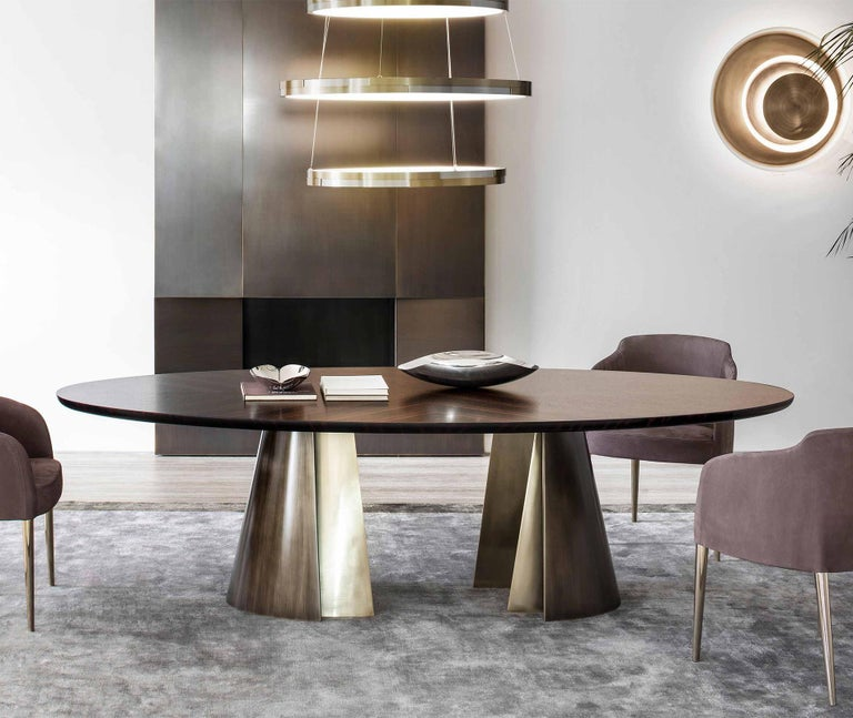 Dining table comet with solid ebony top and with 2 bases in solid bronze in patinated finish, price: 19500,00€. Also available with calacatta marble top, Price: 27900,00€.