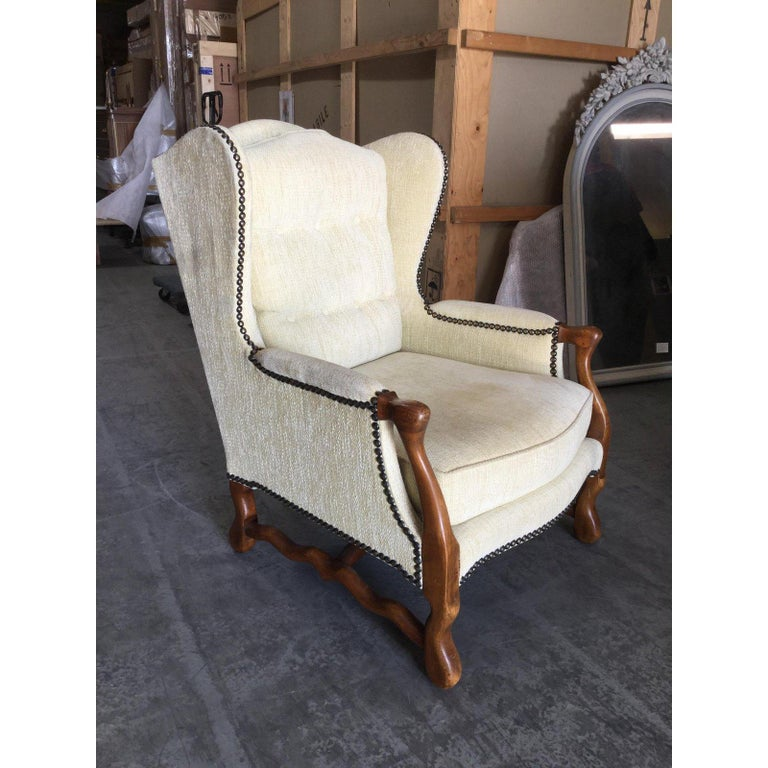 Stunning pair of French Bergere chairs. Offering the utmost comfort, these chairs are wide , deep, and inviting. While remaining stylish. Newly upholstered in an off-white velvet chenille fabric, these chairs are built of French oak with Louis