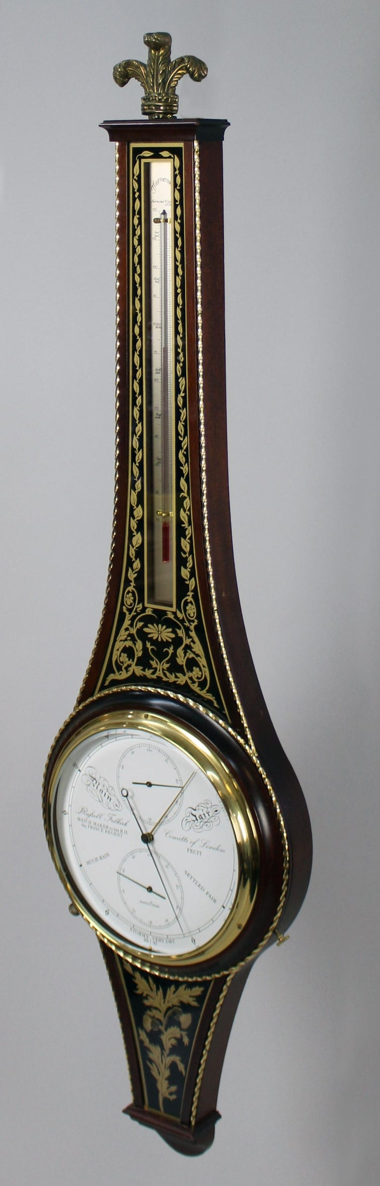 Period  Late 20th century  Maker  Comitti of London  Limited Edition  10 of 50, brass plaque to the reverse  Measures: Width  27 cm / 10 1/2 in  Height  101 cm / 39 3/4 in  Case  Mahogany brass inlaid case  Condition  Very good