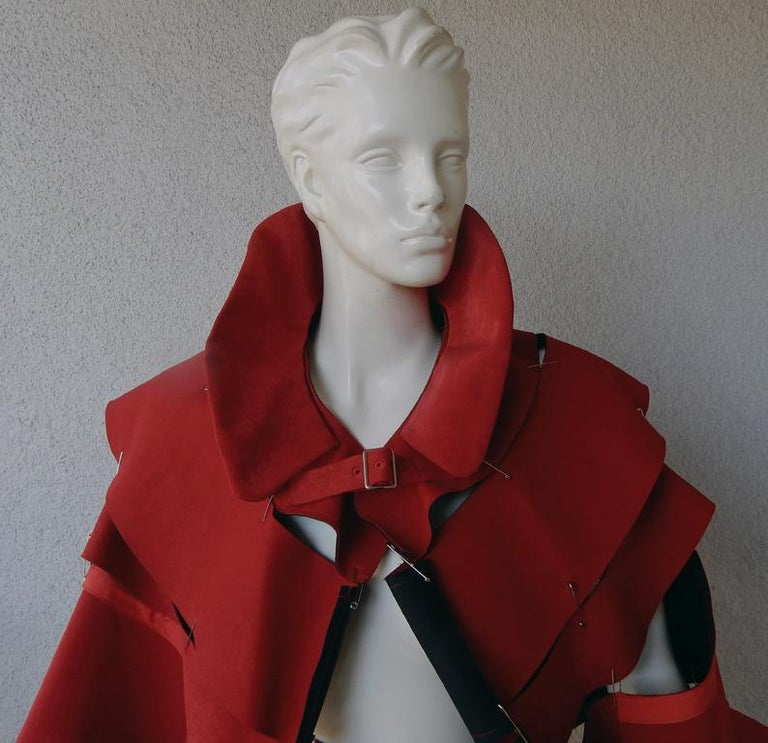 Rei Kawakubo for Comme des Garcons S/S 2015 offers a runway collection of designs in widely different textures and silhouettes all in identical shade of explosive poppy red.  Known as the