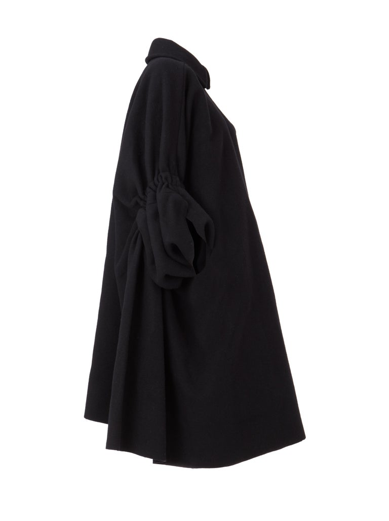 Black Comme des Garçon Coat, with batwing ruched sleeves detiling, and oversized style. Circa 1995