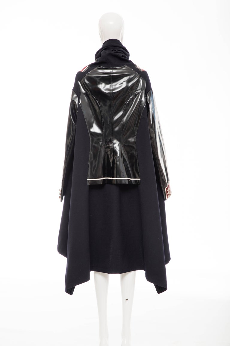 Comme des Garçons, Autumn-Winter 2009 black, coat featuring black, red , white inset vinyl panels throughout, shawl collar, button accents at bodice, dual seam pockets and single button closure at front.  Japan: Medium  Bust: 60, Waist 70, Shoulder