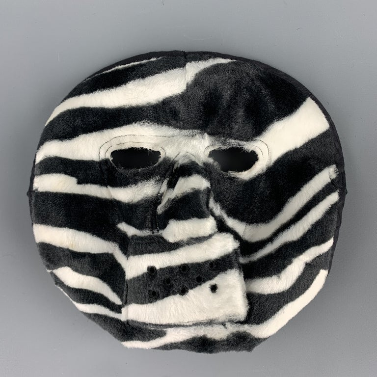 COMME des GARCONS HOMME PLUS F/W 2015 Mask comes in a zebra black and white pattern rayon material, with a cotton lining. Made in Japan.  Excellent Pre-Owned Condition.  Measurements:  Width: 9.5 in.  Height: 10 in.