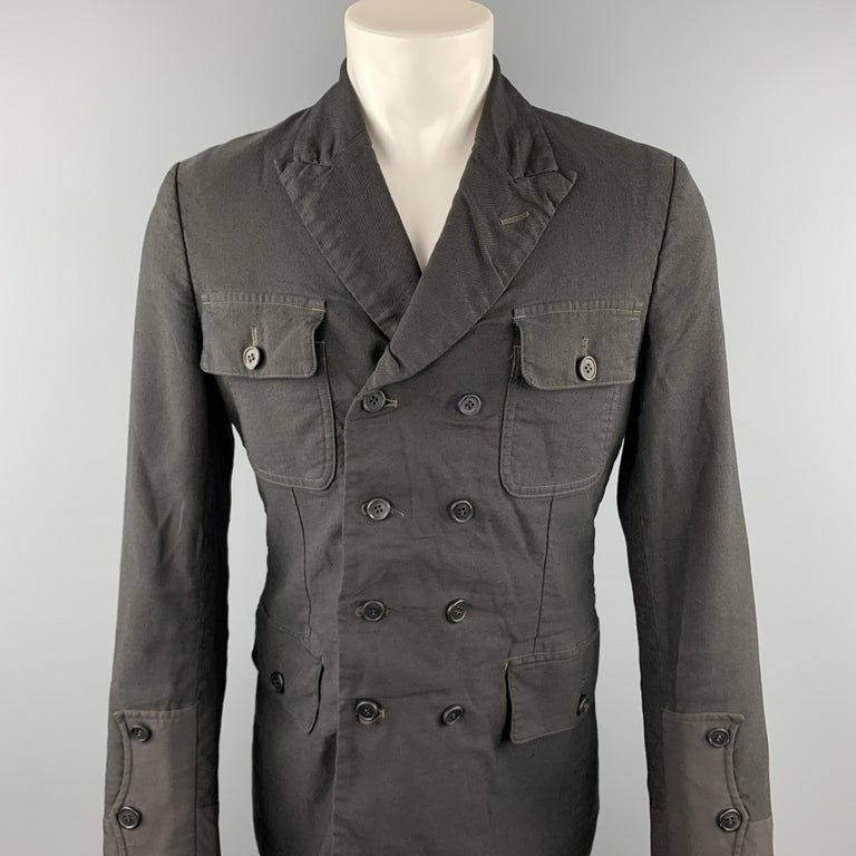 COMME des GARCONS HOMME PLUS jacket comes in a black linen / polyester featuring a peak lapel, patch pockets, and a double breasted closure. Made in Japan.  Very Good Pre-Owned Condition. Marked: M / AD2014  Measurements:  Shoulder: 17.5 in.  Chest: