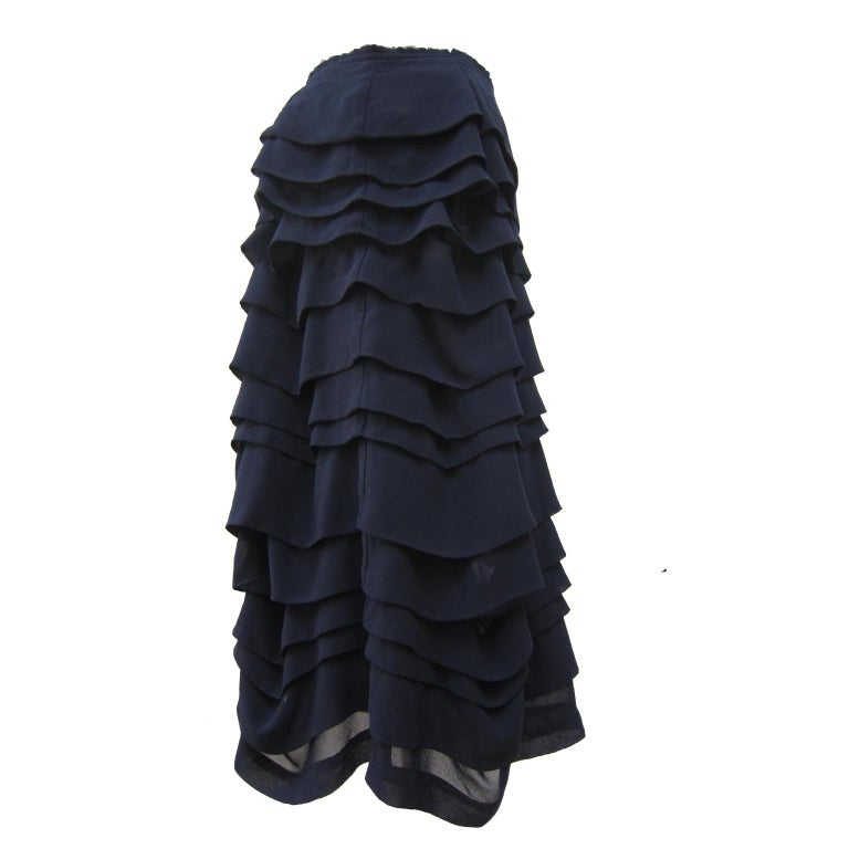 Comme Des Garçons ruffle layered beautifully volumed skirt from AD 2004. Featuring layers of folded ruffles stitching throughout with unfinished waist line.  Size : M Waist : 37 cm Length : 66 cm