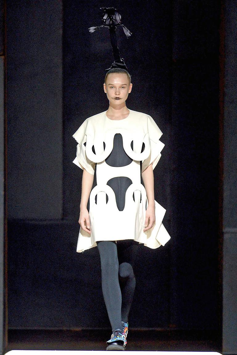Rei Kawakubo's collection for Comme des Garcons S/S 2014 denotes a collection creatively unfettered by rules and formulas normally used in the fashion industry.  In this collection the designer creates fashions in the form of hanging objects on the