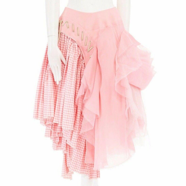 COMME DES GARCONS FROM THE SPRING SUMMER 2005 COLLECTION PART OF THE FIT MUSEUM COLLECTION Cotton, polyester, nylon • Pink gingham checkered cotton on right • Pink ruffled voluminous tulle on left • Off white leather overstitched detail down center