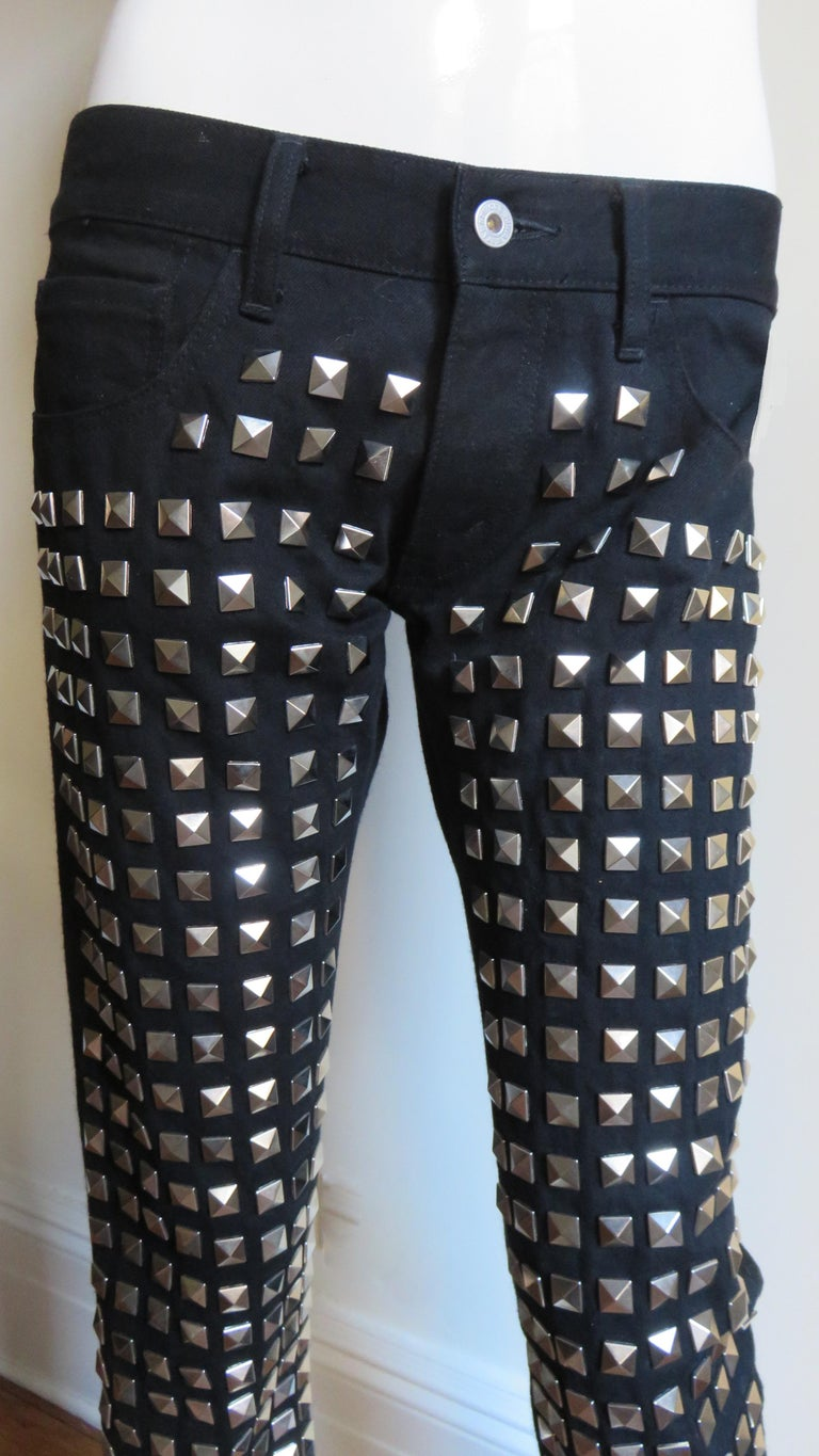 Fabulous black wool and cotton pants from Junya Watanabe for Comme des Garcons, CDG AD 2015 collection.  They are low rise, straight leg jean style with 2 front pockets, and 2 back patch pockets. The pant front is cotton covered in rows of silver