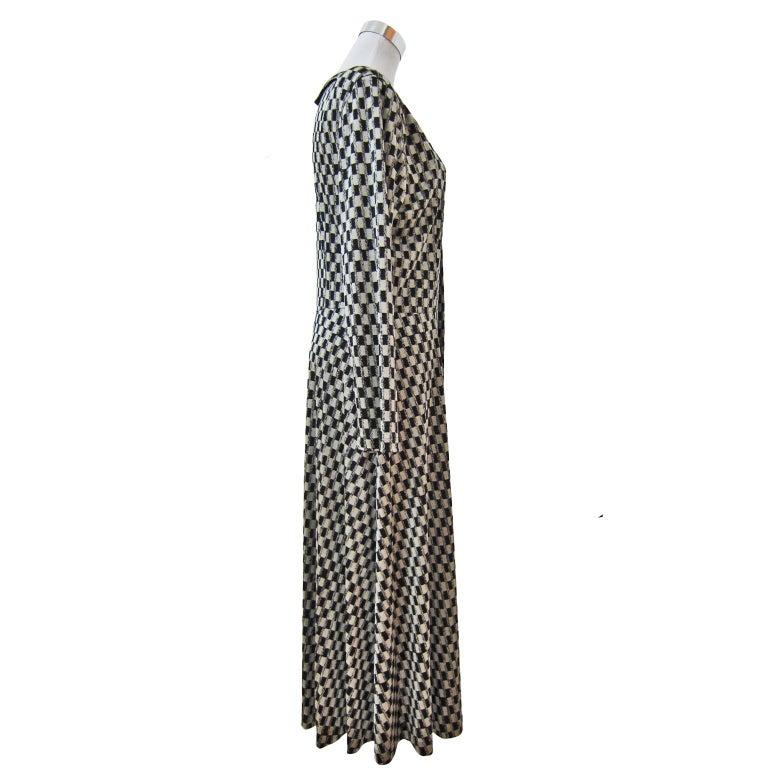 Comme des Garcons Tricot playful 3D checkered pattern dress coat from early 1980s collection. Front button closure, round collar back / front.  Size :  Measurements ;  Waist : 39 cm Shoulder : 44 cm Length : 120 cm Under arm : 49 cm
