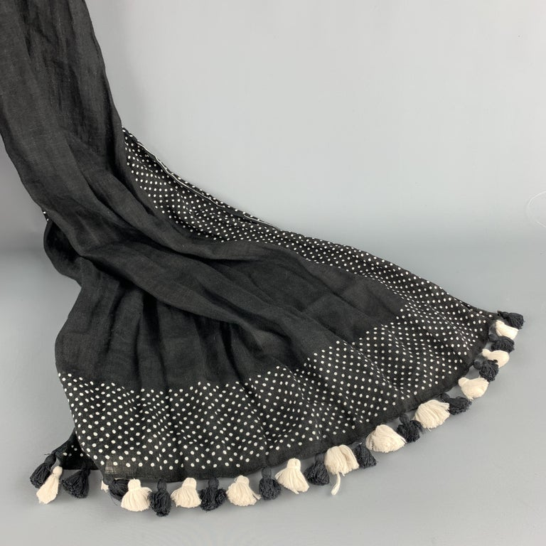 COMME des GARCONS TRICOT shawl scarf comes in black and white speckled linen with micro polka dot panels and tassel fringe trim.   Excellent Pre-Owned Condition.  Length: 70 in. Width: 29 in.