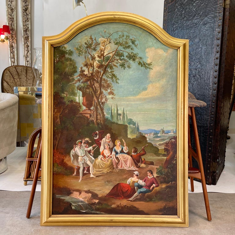 Italian large scale oil on canvas painting from the Commedia dell'arte genre depicting nobles and masked figures in a pastoral setting. Apparently unsigned.