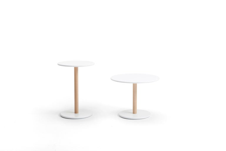 Low tables for home and commercial establishments inspired by the Japanese classics and designed by Naoto Fukasawa for Viccarbe  Two different sizes make them very flexible and suitable for a variety of uses.  Constructed with a natural beech column