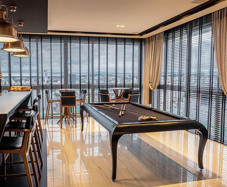 The Milan Dining Pool table is Larissa's modern take at the classic lines of indoor pool tables. The table's dynamic visual throwback to a neoclassical school of design, such as the it's thin and curved chippendale feet, is complemented by the