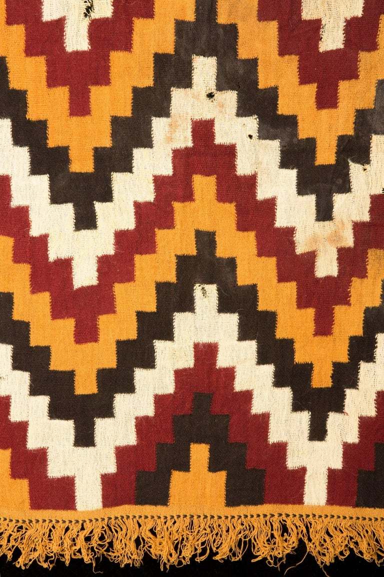 Complete textile panel with zig-zag patterns in white, yellow red and black or brown shades.