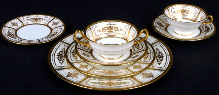 Burnished Complete Service for 12 of Minton for Tiffany Neoclassical Style Gilded Plates For Sale