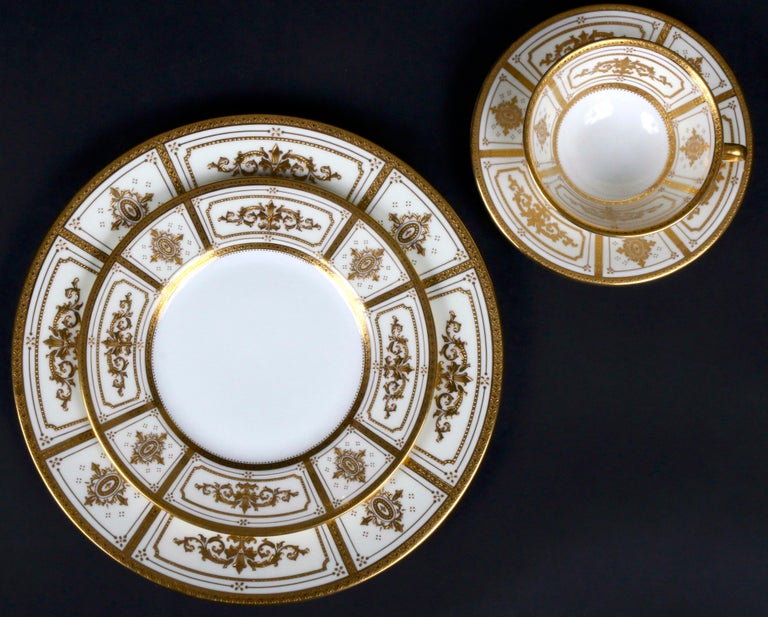 Mid-20th Century Complete Service for 12 of Minton for Tiffany Neoclassical Style Gilded Plates For Sale