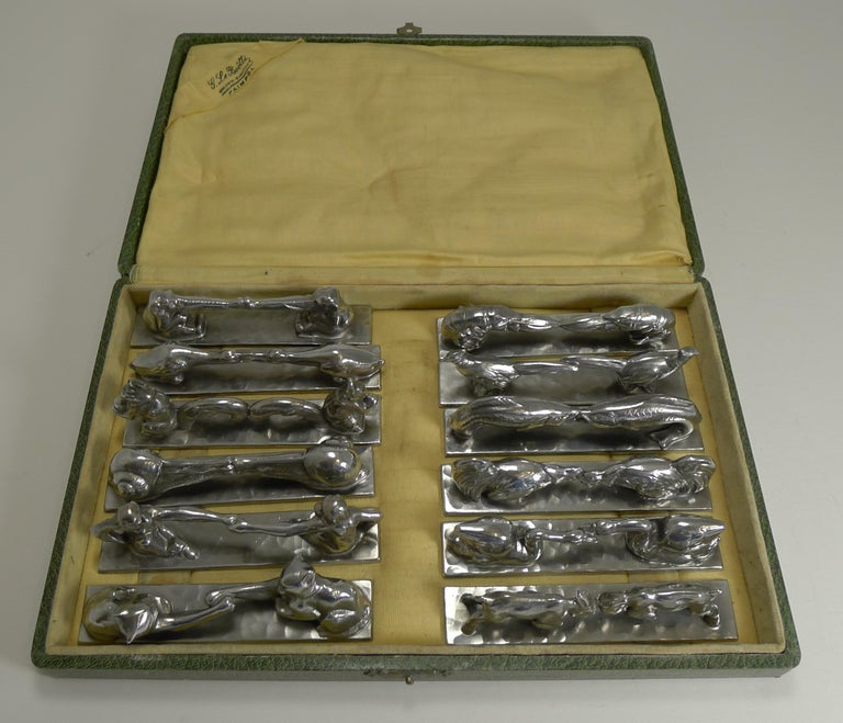 I have seen individual or incomplete sets of these over the years, this is a complete set of twelve polished pewter figural / novelty knife rests, all different pairs of animals.  The underside of each is signed Etain D'art / Titre Legal / Made In