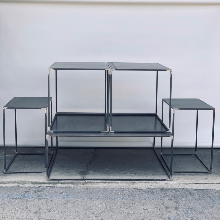 Complete set of 'Filiforme' coffee, side and occasional patinated steel plate tables by Design Frères. Inspired by the Wabi-Sabi Minimalist aesthetic philosophy updated by designers such as Axel Vervoordt.  Measures: Coffee table 43 in. x 43 in. x