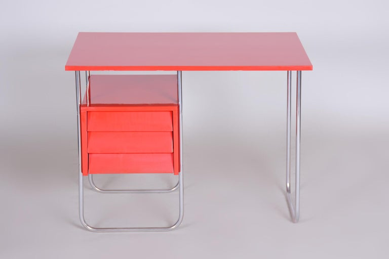 Writing desk made in Czechoslovakia Material: Chrome, lacquered wood Completely restored. Period: 1940-1949.