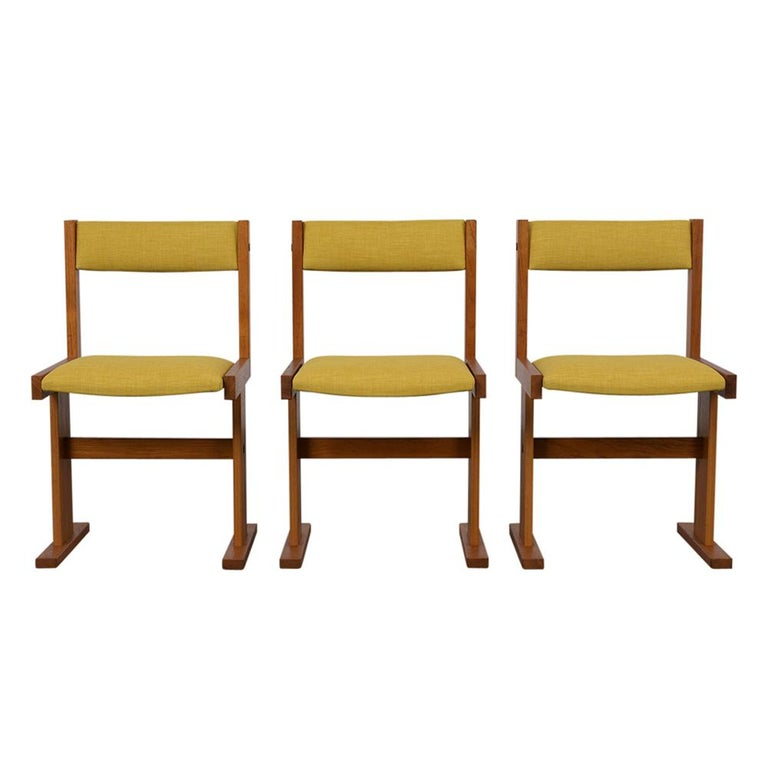 Completely restored 1960s set of six midcentury dining chairs, reupholstered in mustard fabric and finished with a beautiful provincial color finish. Chairs are very sturdy and ready to be enjoyed in any home for years to come.  Measures: Seat