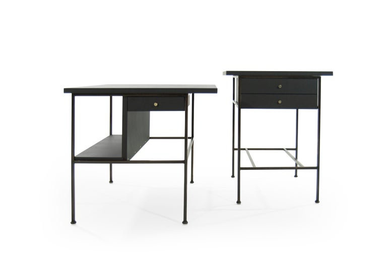 An important set of fully restored bronze side tables designed by Paul McCobb, circa 1950s.  Bronze frames have been fully restored and sit in mint condition, hand-polished brass hardware. Mahogany tops and drawers have been ebonized, topped in an