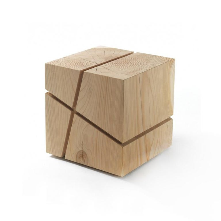Stool Concepta Cedar made in a block of natural cedar trunk. With perpendicular lines which runs along the six faces. Treated with wax with natural pine extracts. Solid cedar wood include movement,  cracks and changes in wood conditions,  this is
